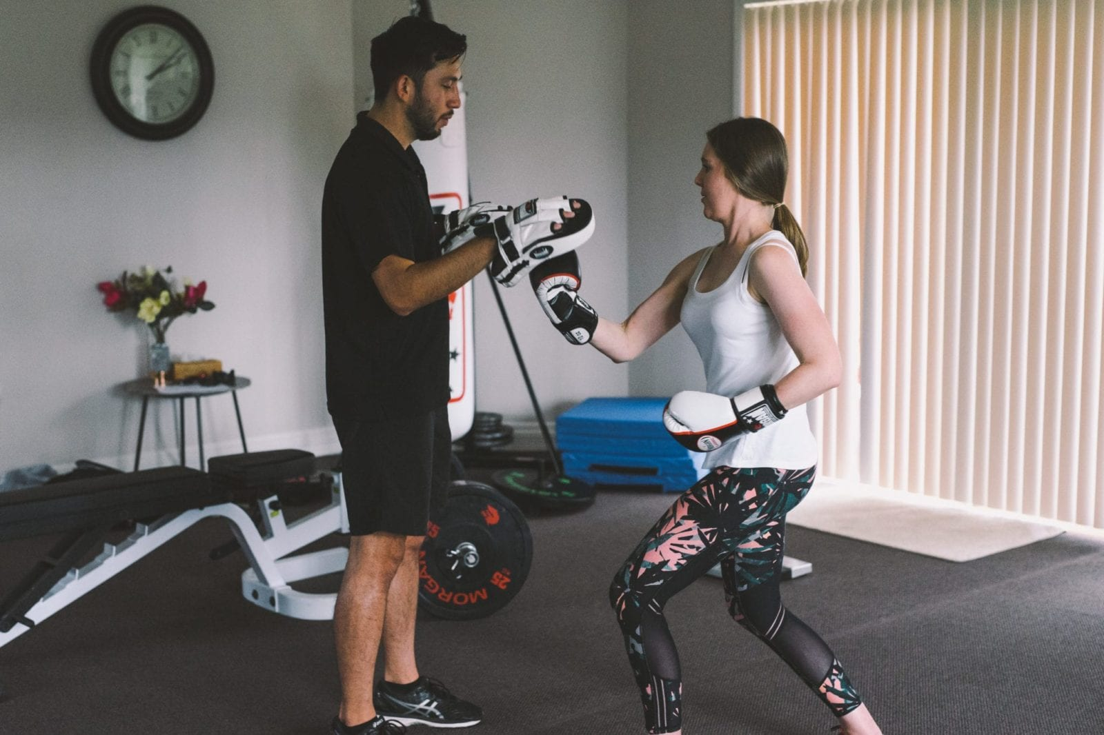 Woman boxing with trainer